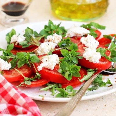 Tomato basil ricotta salad recipe on a plate beautiful image